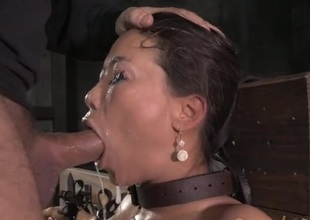 Fastened Asian drenched in spit as they orientation fuck her