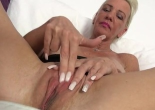 Granny hither big fake tits fingers her pussy