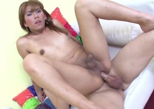 Tgirl has a ramrod in her tight butt from behind