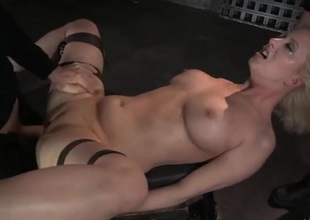 Throat and cunt of a bound hotty normal by two guys