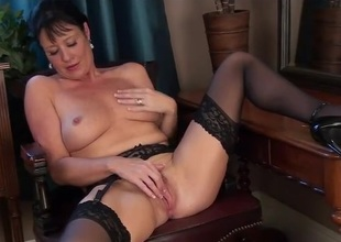 Classy milf beauty in black nylons rubs their way sexy cunt